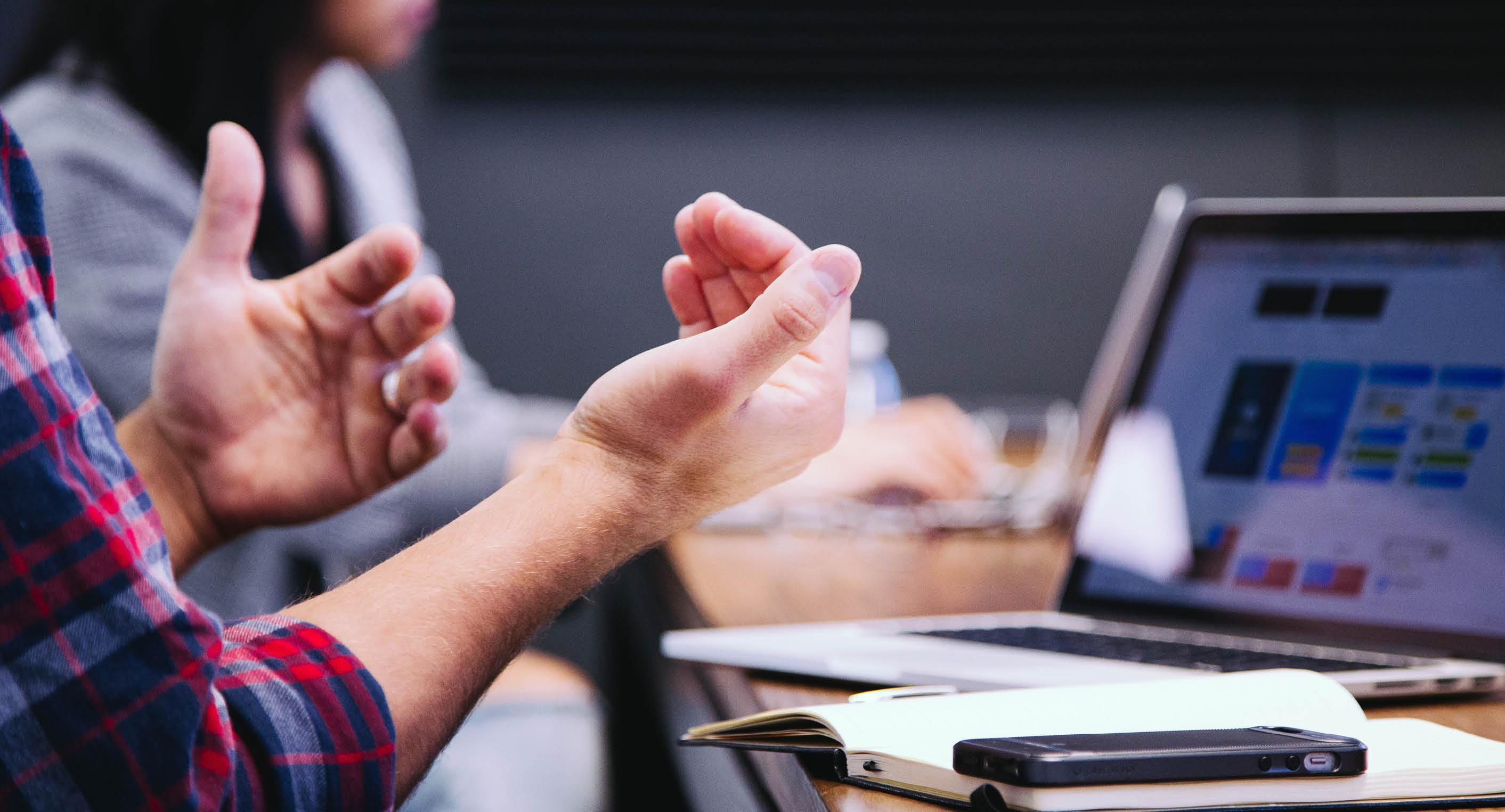 Featured-Hands in meeting-1