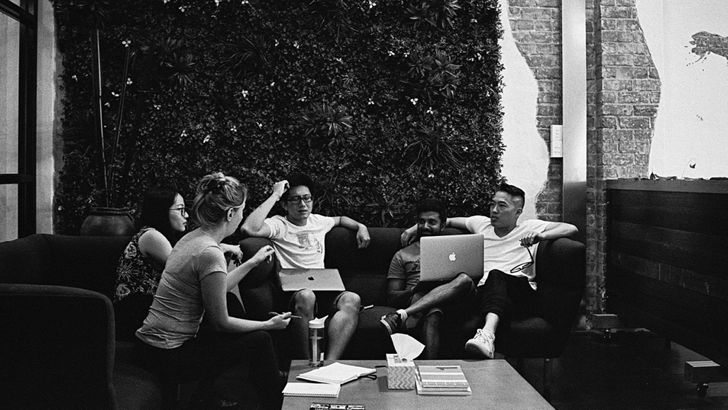 Skilled workers collaborating together on a couch